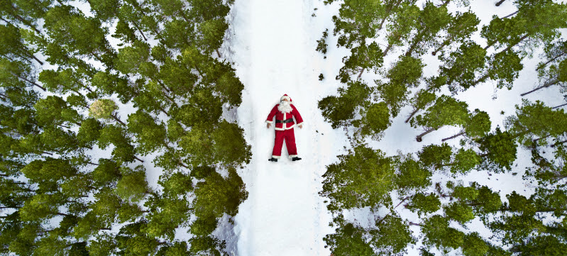 Santa laying in the snow